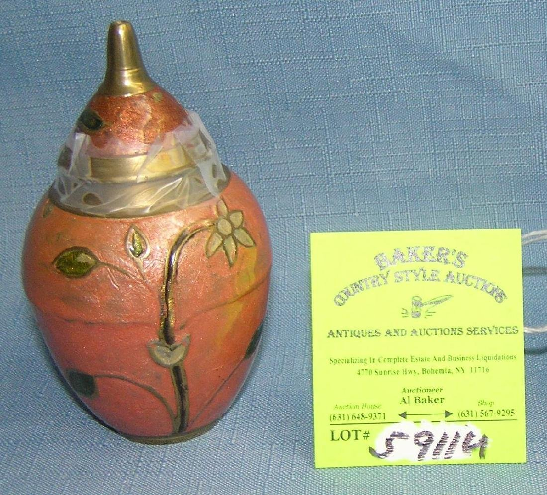 Brass and enameled oriental vase with cover