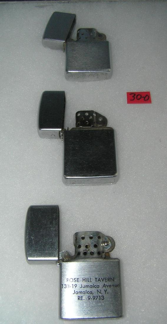 Collection of vintage lighters includes Zippo