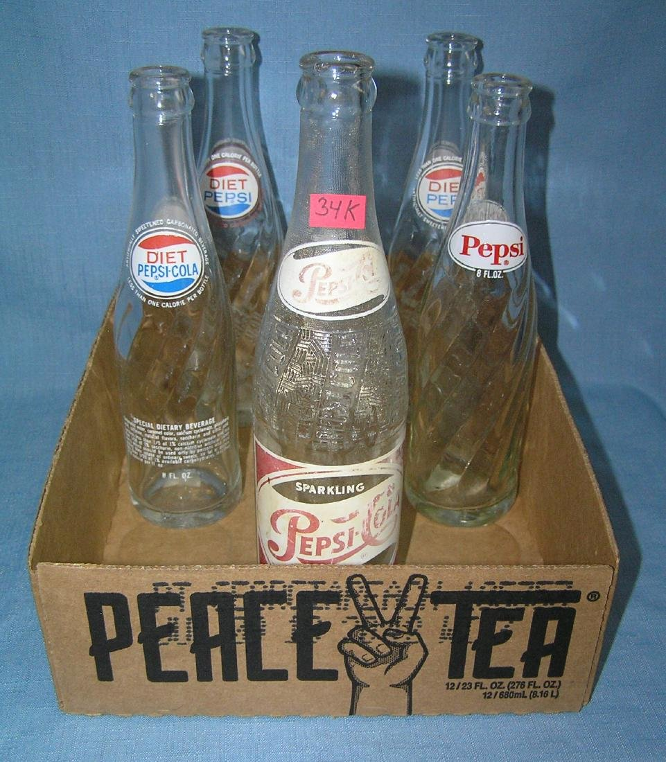 Collection of vintage Pepsi soda bottles