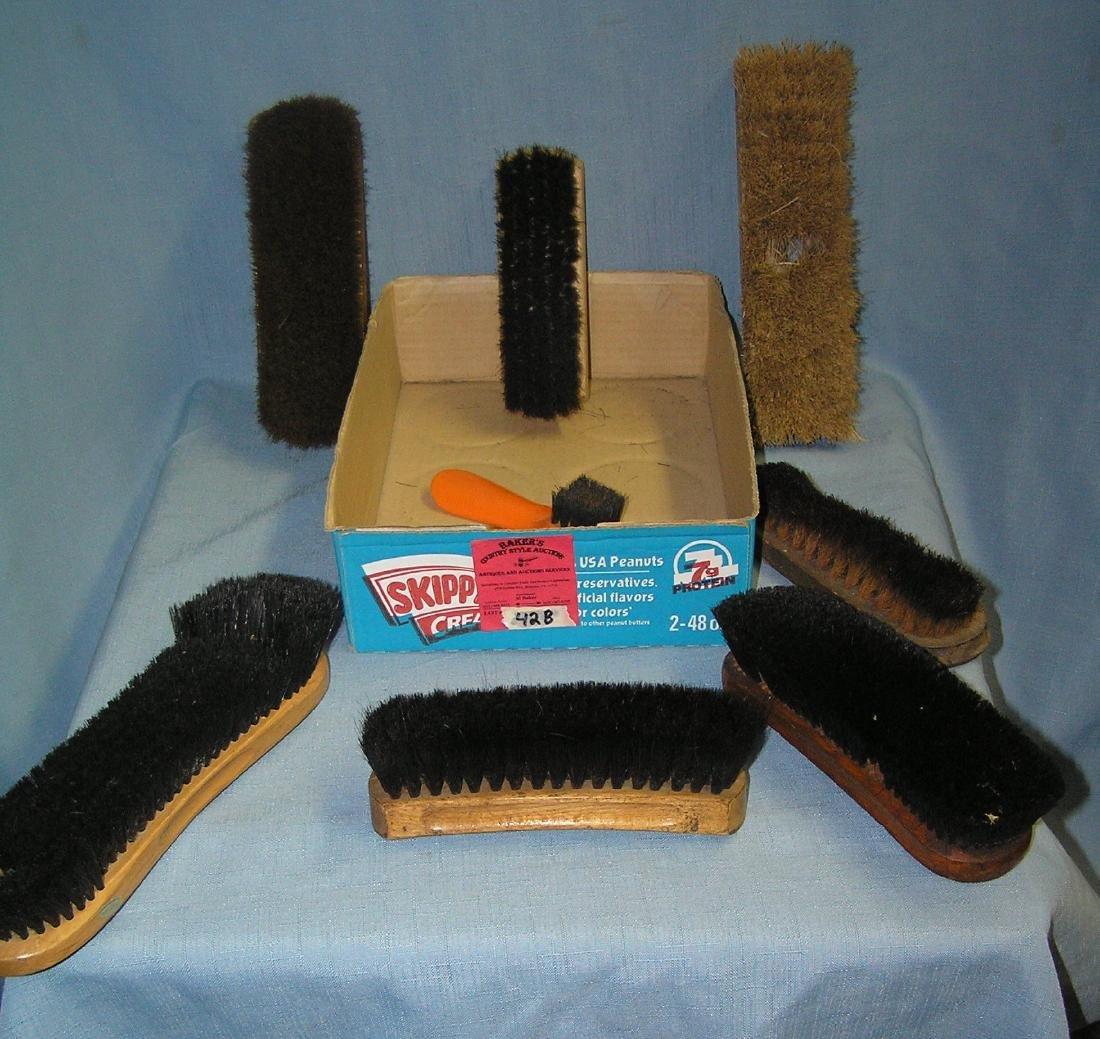 Box full of vintage shoe shine brushes
