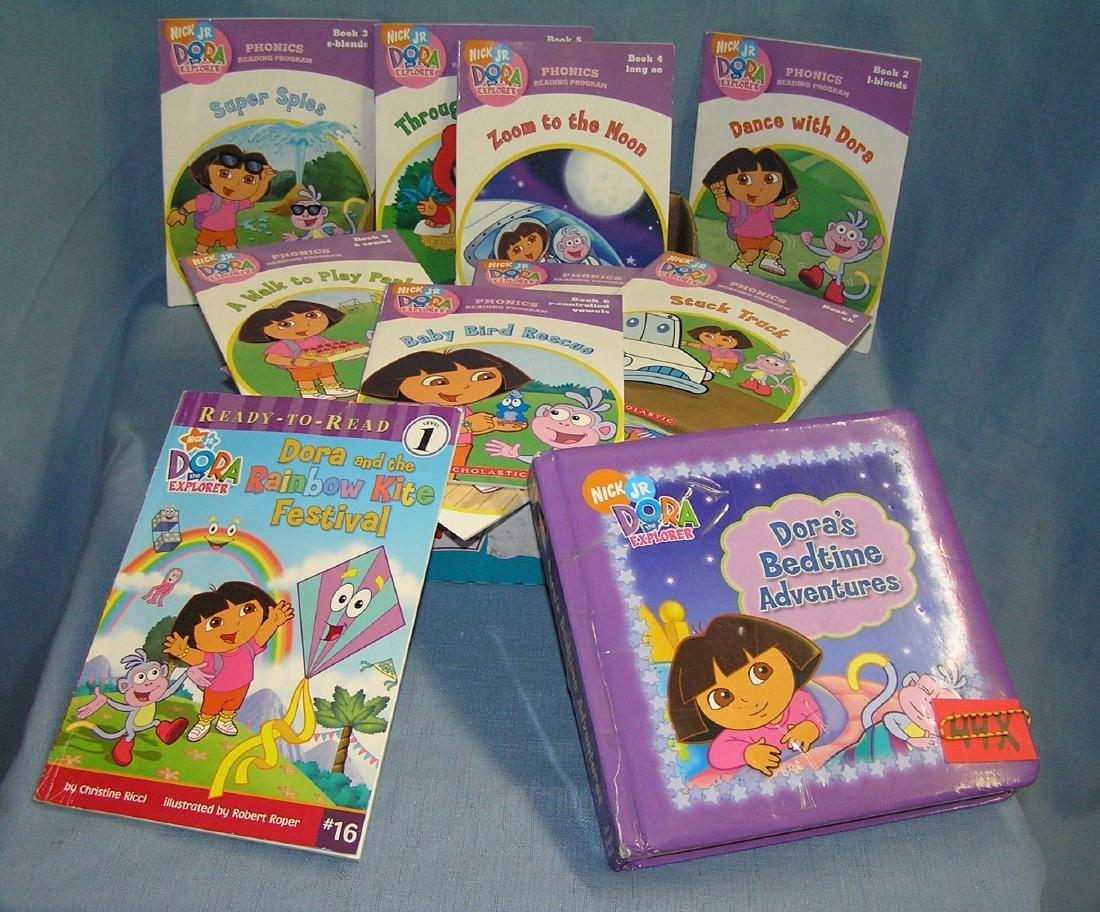 Box full of vintage Dora the Explorer children's books