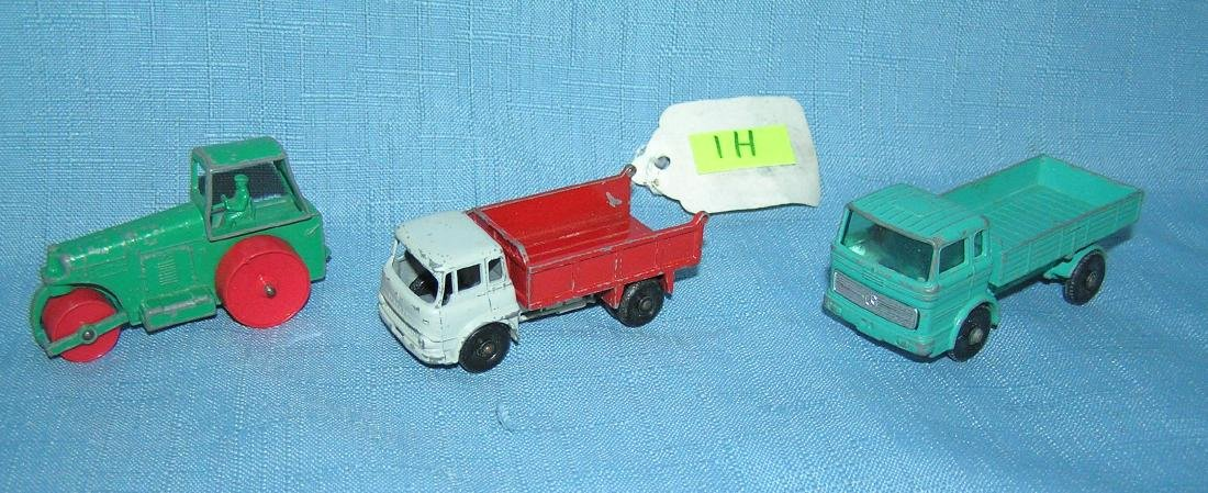 Group of 3 early matchbox toy trucks