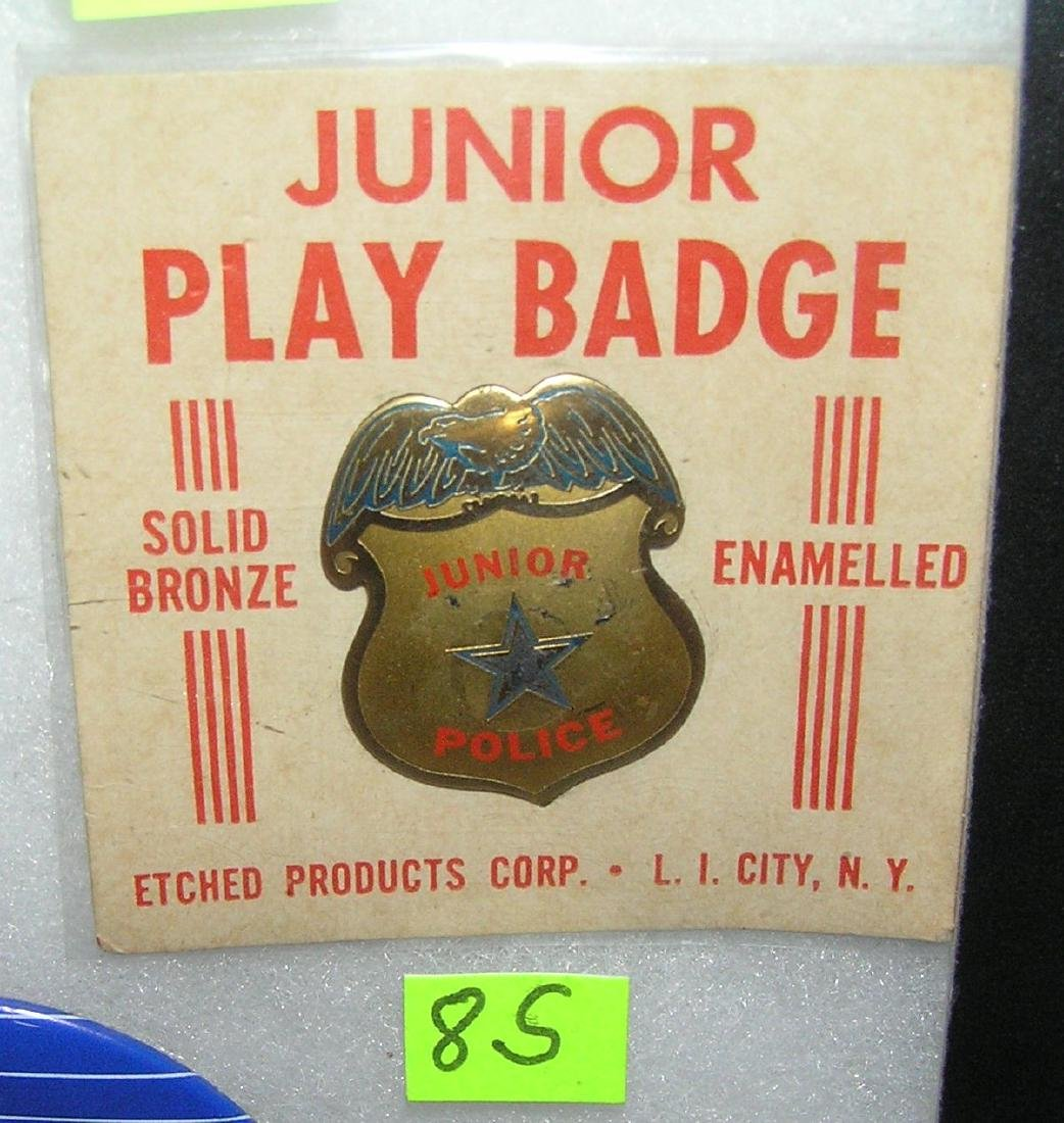 Junior police badge all brass mint on card