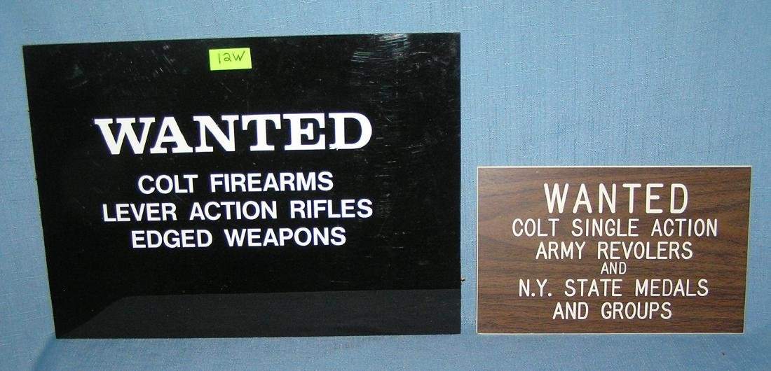 Pair of vintage Colt firearms wanted signs