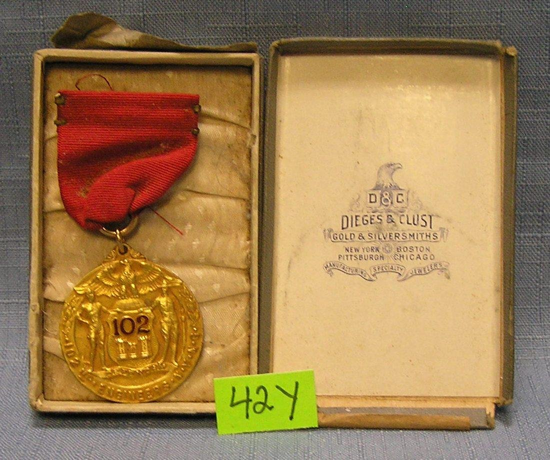 Early gold filled basketball medal and ribbon