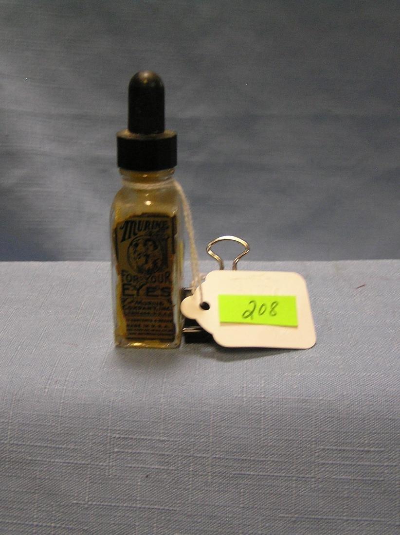 Antique Murine eye drop bottle