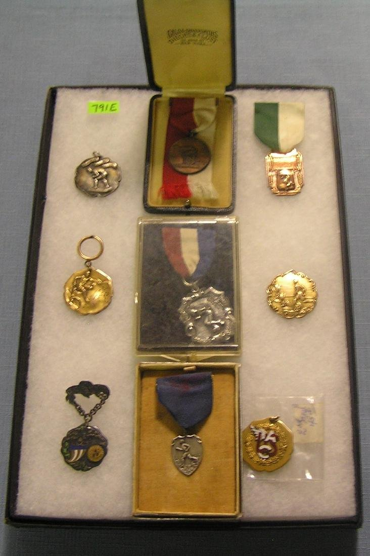 Group of early track & field medals and awards