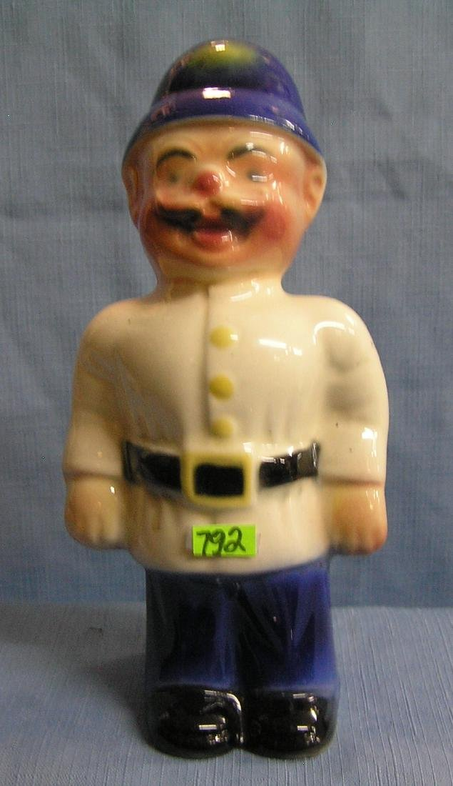 Antique porcelain policeman figure