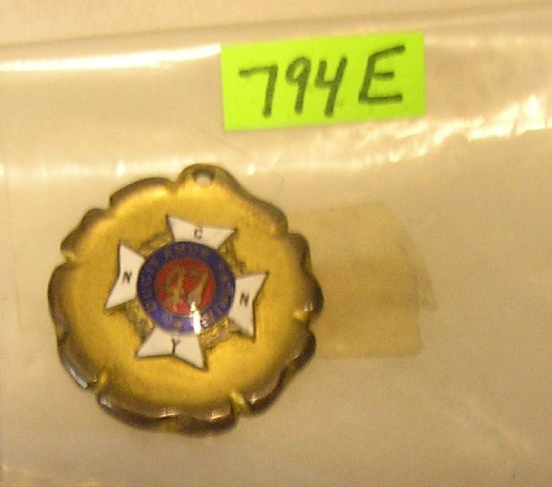 Early enameled and bronze badge