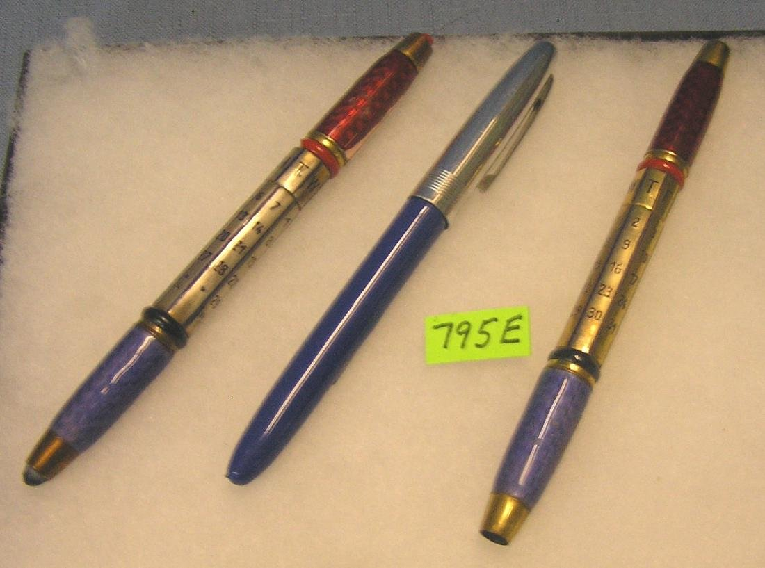 Group of three antique pens
