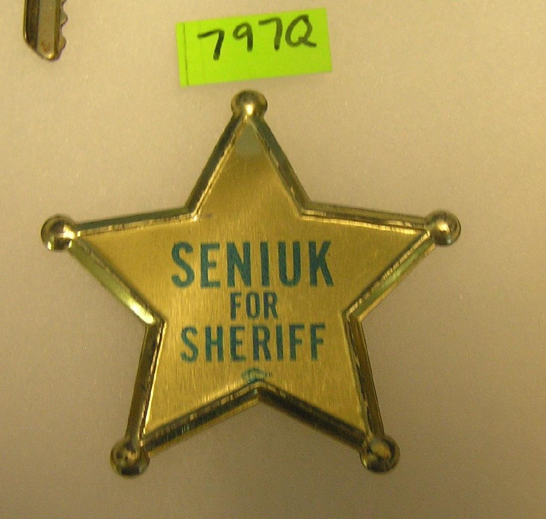 Vintage tin Seniuk for sheriff campaign badge