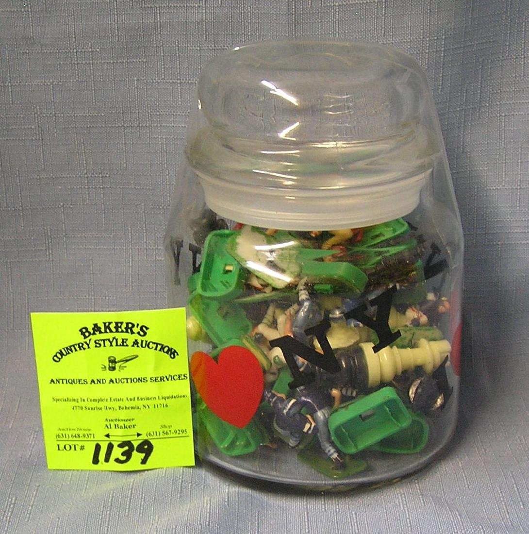 Glass jar full of vintage toys and collectibles