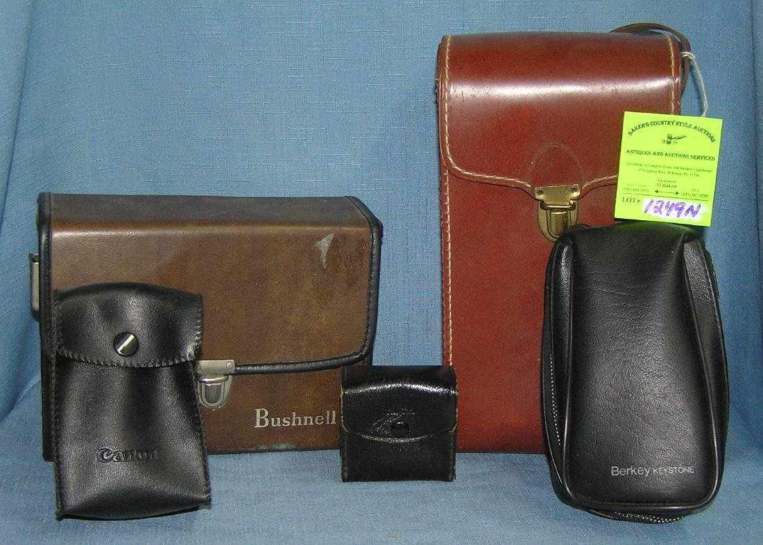 Group of camera cases and holders