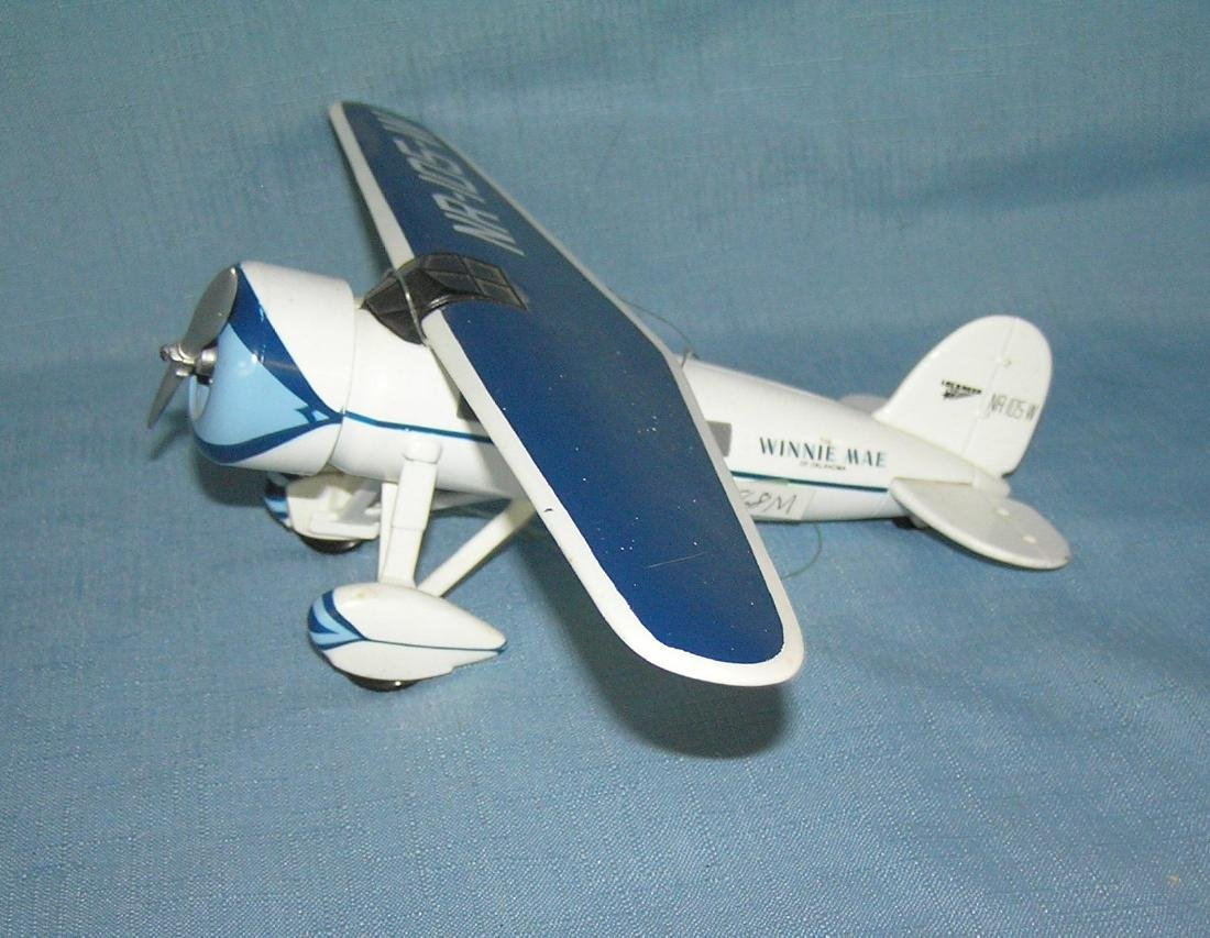 All cast metal Lockheed Winnie Mae propeller plane