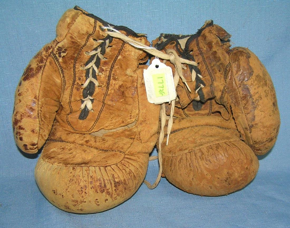 Pair of early leather boxing gloves
