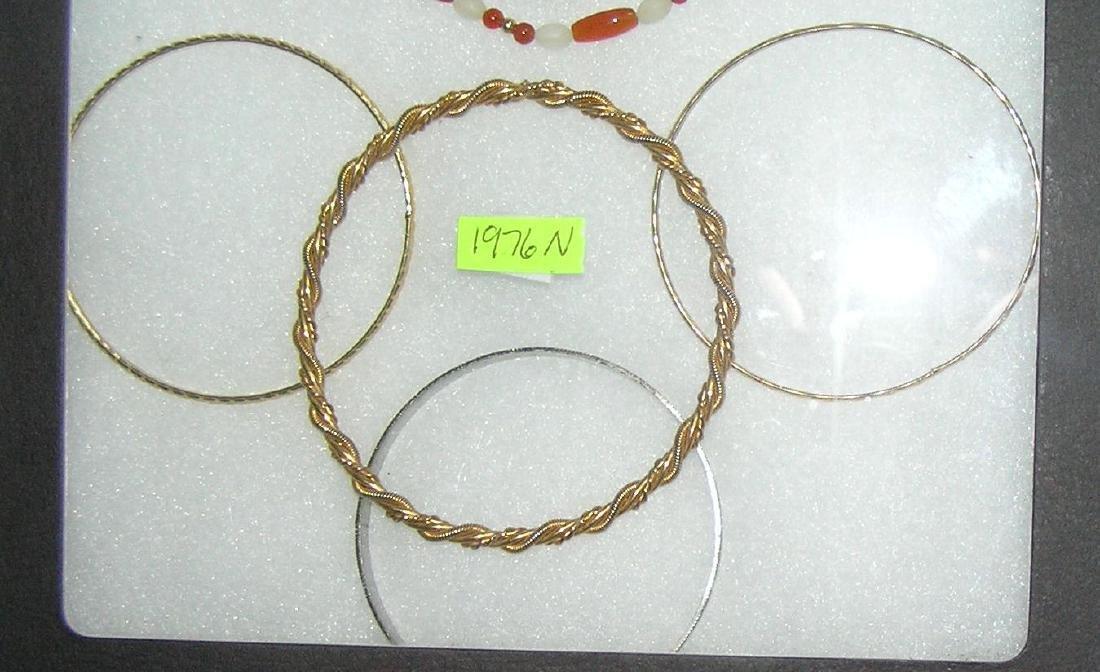 Group of 4 bangle bracelets