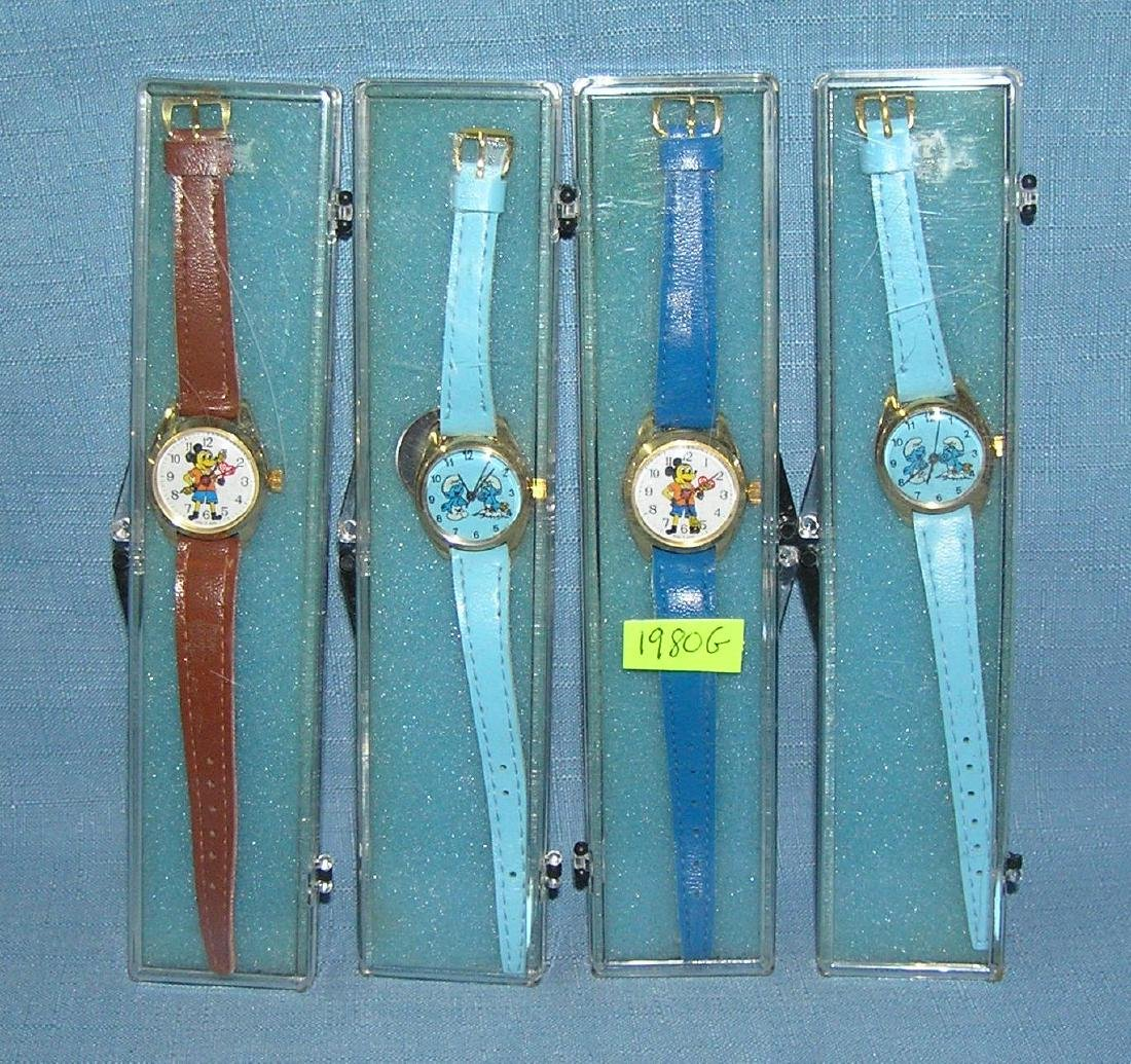 Mickey Mouse and Smurfs character watches