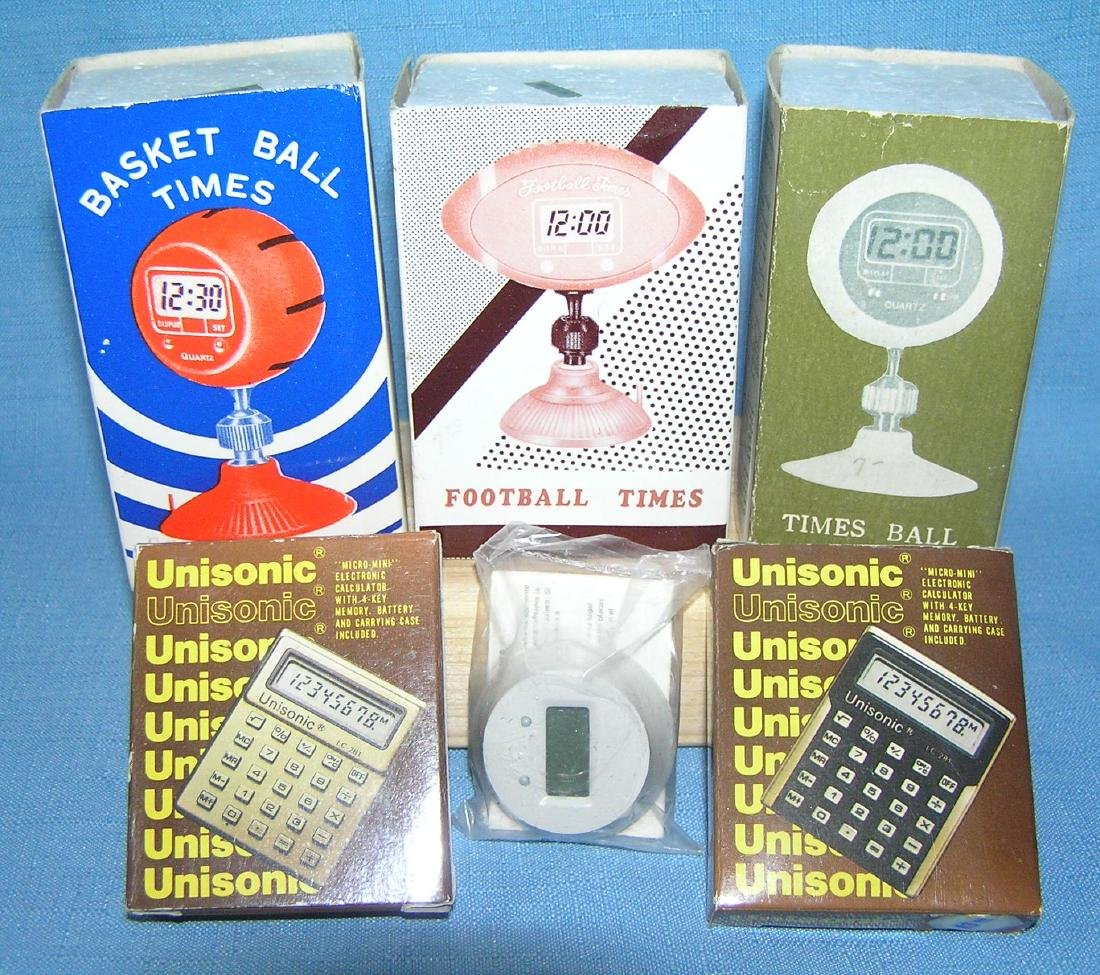 Novelty time pieces and miniature calculators
