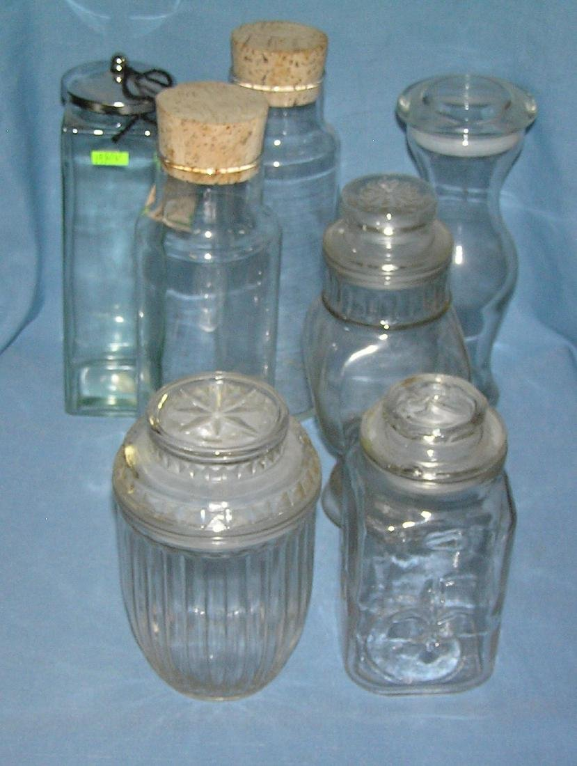 Collection of vintage glass covered storage jars