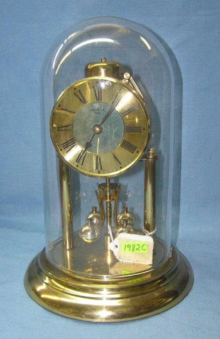 Bucherer quartz brass and glass dome clock