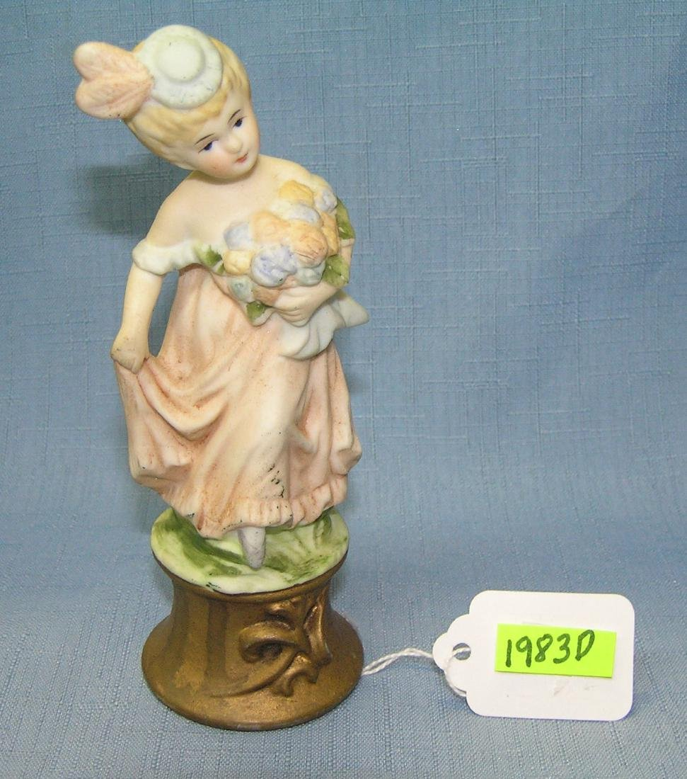 Hand painted porcelain flower girl figurine