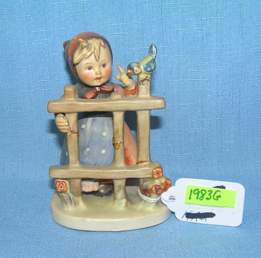 Girl at fence with bird Hummel figurine