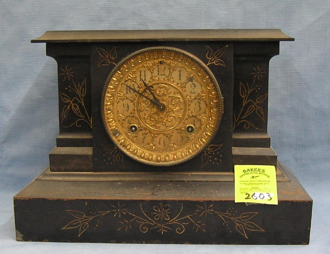 Antique cast iron mantle clock with gold trim