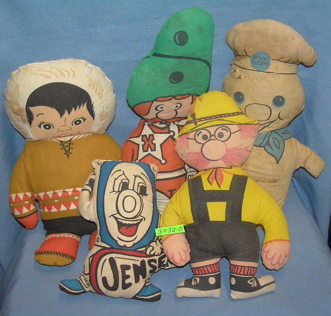Group of vintage cartoon and advertising dolls
