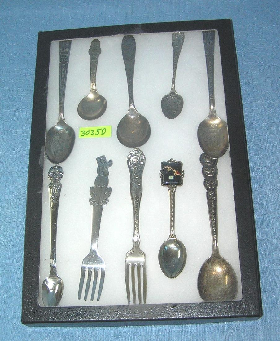 Collection of character and souvenir spoons