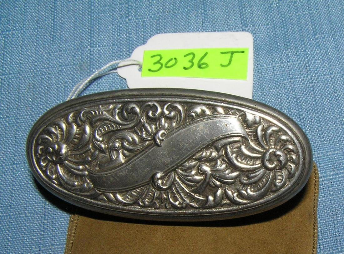 Antique purse with silver plate trim and opening