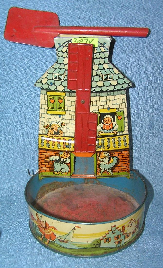 Group of early tin toys