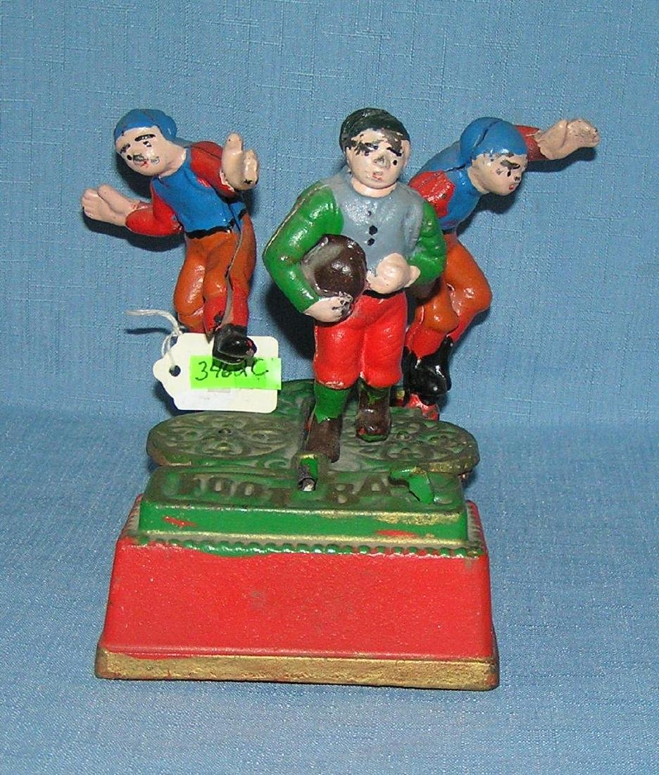 Hand painted cast iron football mechanical bank
