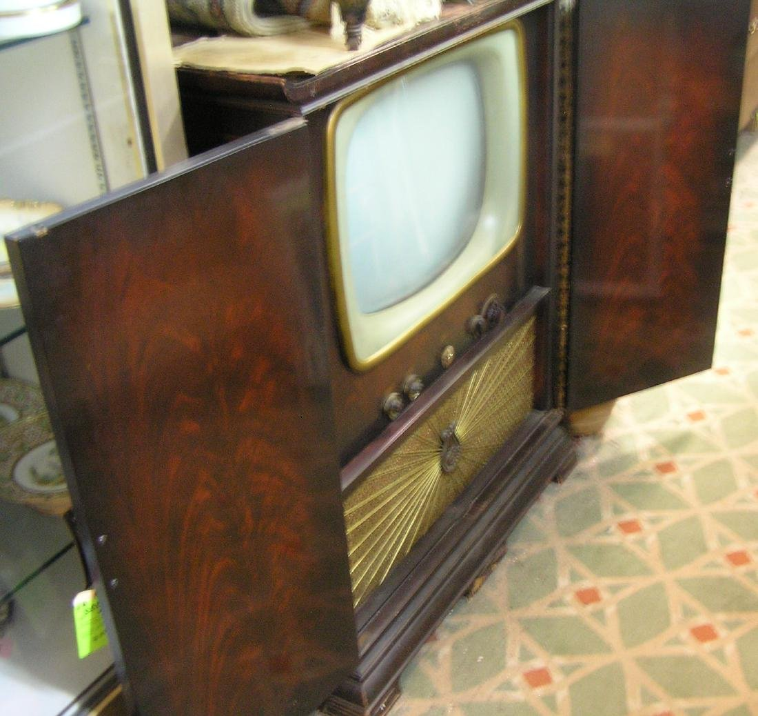 Antique television set in oriental themed cabinet