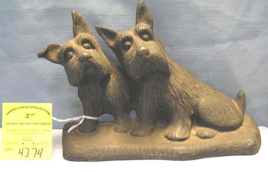 Early cast iron Scottie dogs door stop