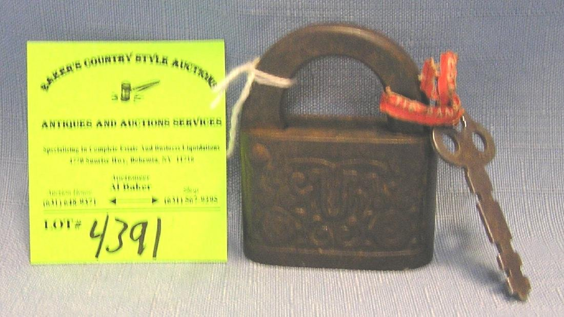 Antique cast iron padlock with key