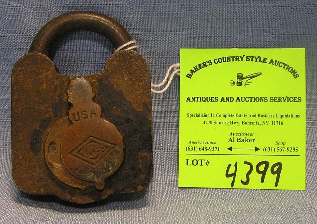 Antique cast iron, steel & brass padlock marked Creo