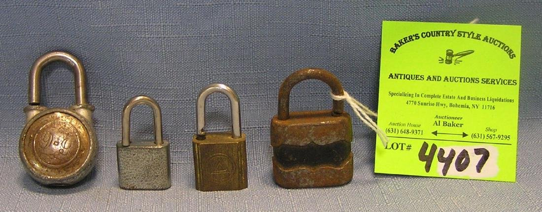 Group of four vintage padlocks