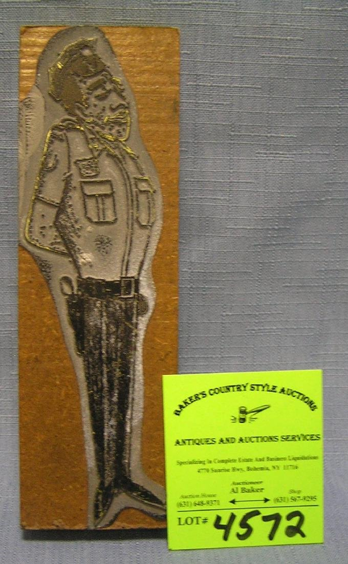 Early metal and wood figural policeman printing plate