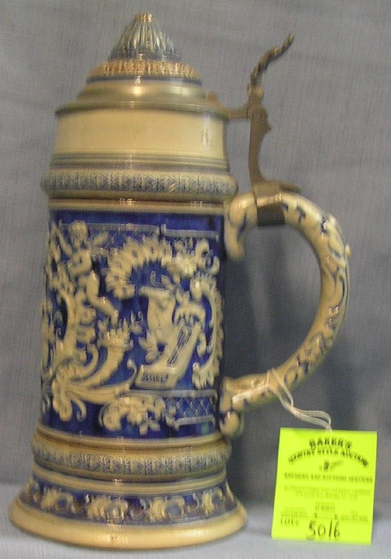 German beer stein with pewter and porcelain lid