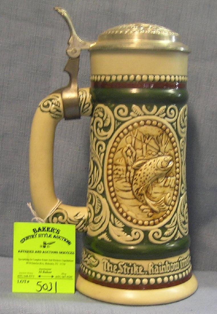 Vintage porcelain beer stein with hunting and fishing