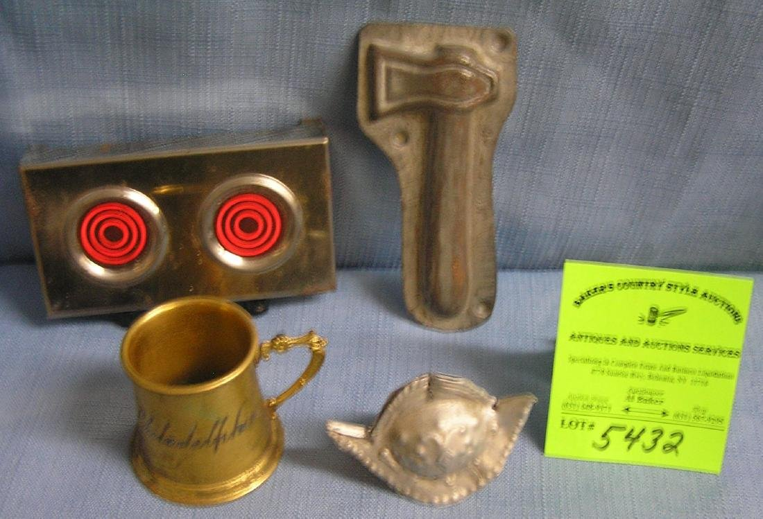 Group of vintage toys, molds, and collectibles