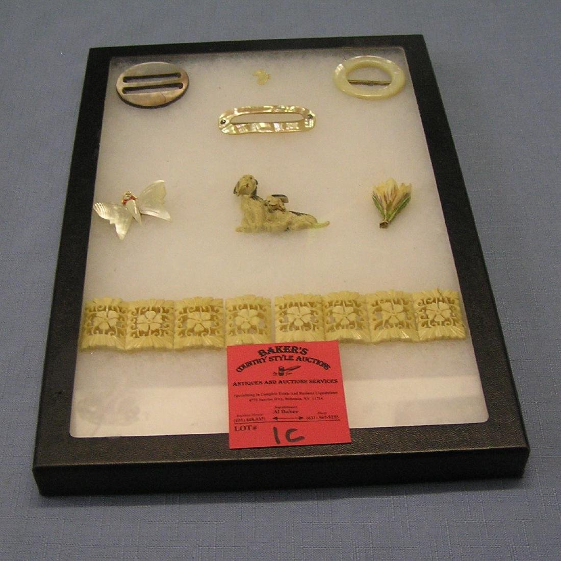 Collection of vintage jewelry pins and buckles