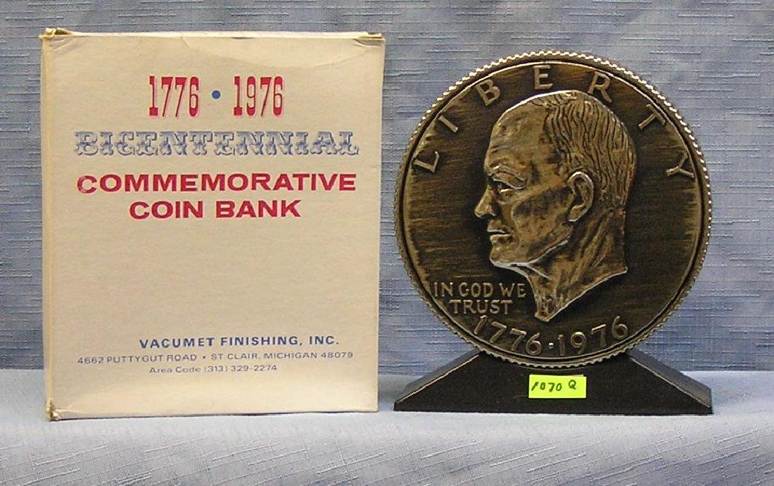 Vintage cast metal Eisenhower dollar coin bank