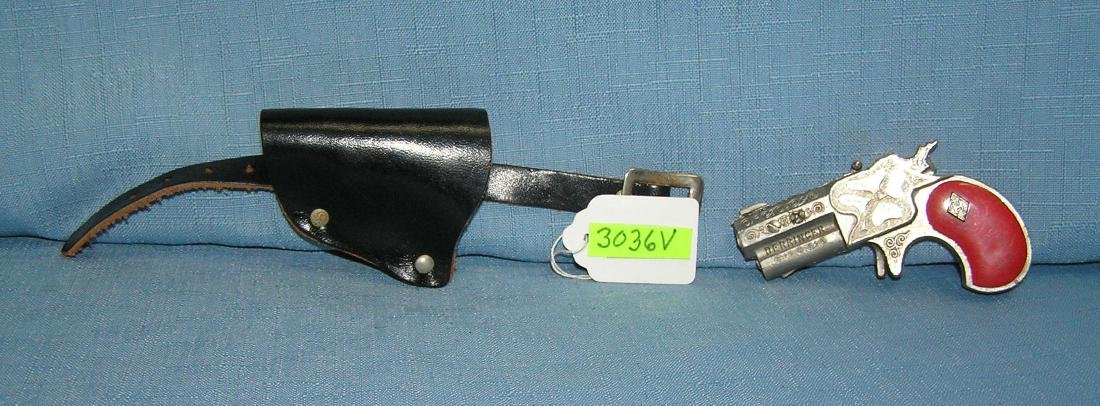 Early all cast metal Derrenger with holster
