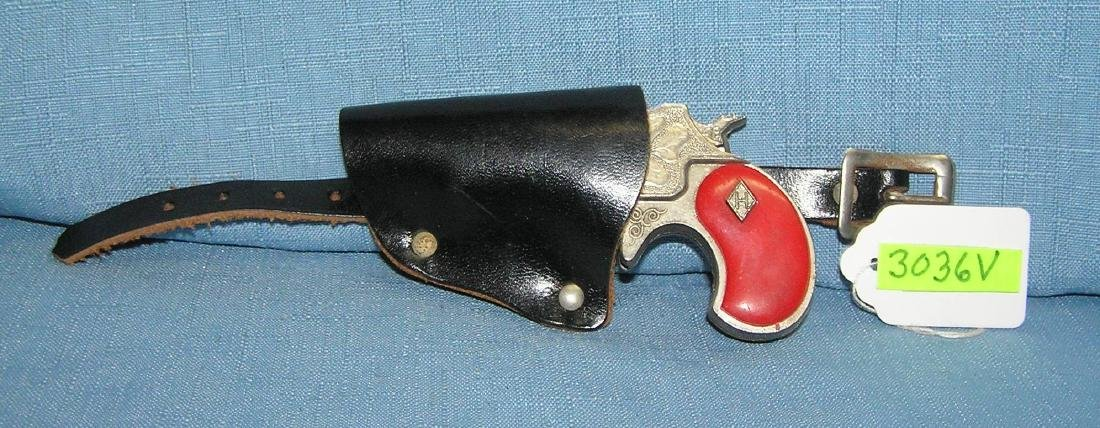 Early all cast metal Derrenger with holster - 2
