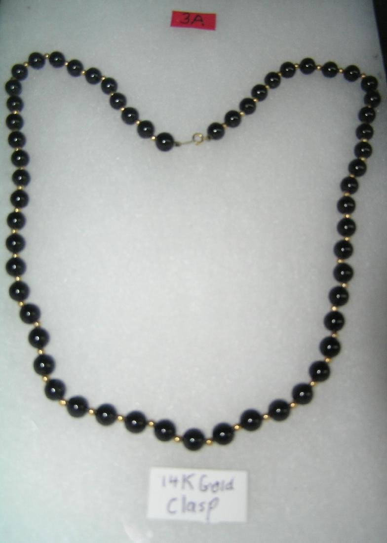 High quality onyx necklace with 14K gold clasp and