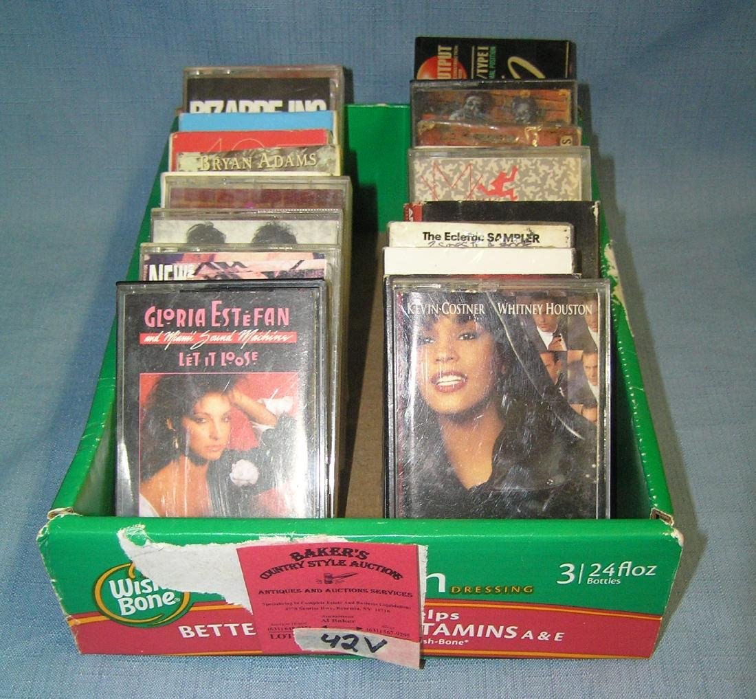 Box full of vintage musical cassette tapes