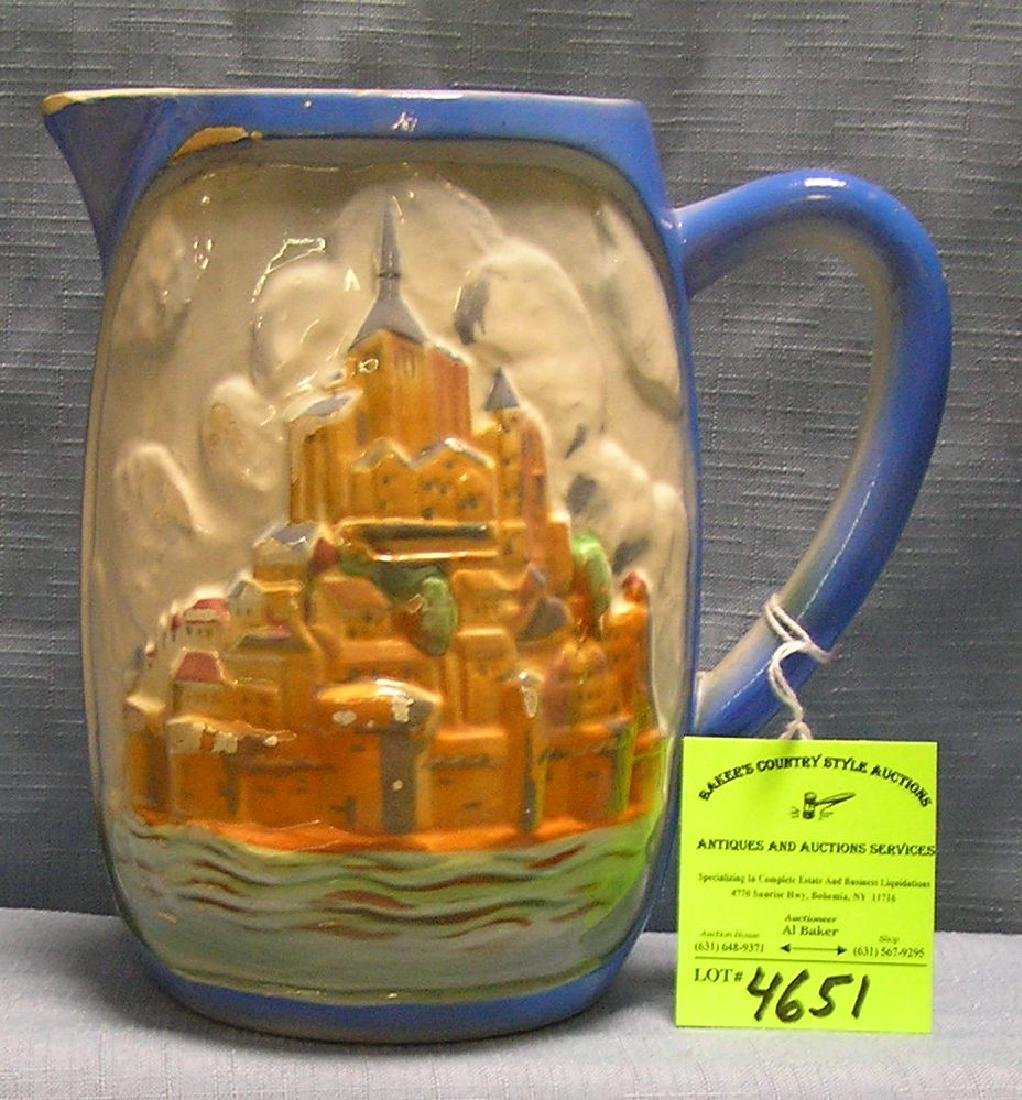 Early castle decorated glazed over art pottery pitcher