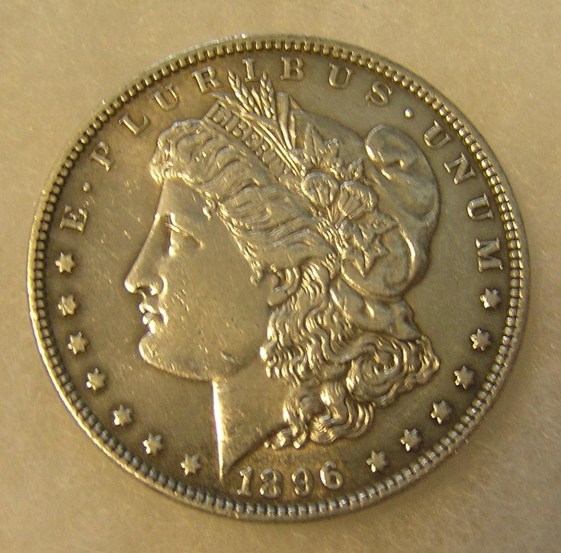 1896 Morgan silver dollar in AU condition
