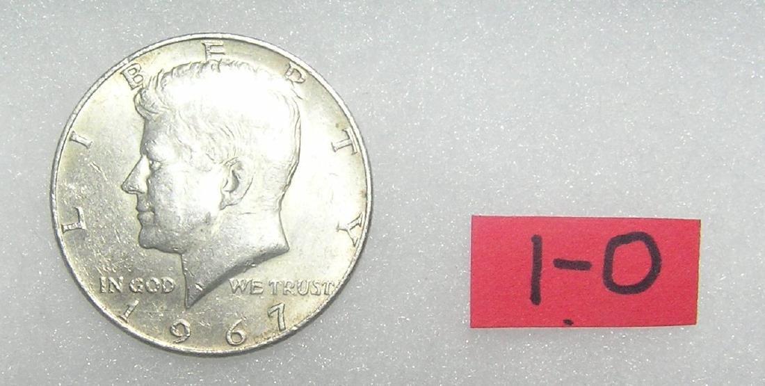 Kennedy Silver clad half-dollar coin dated 1967